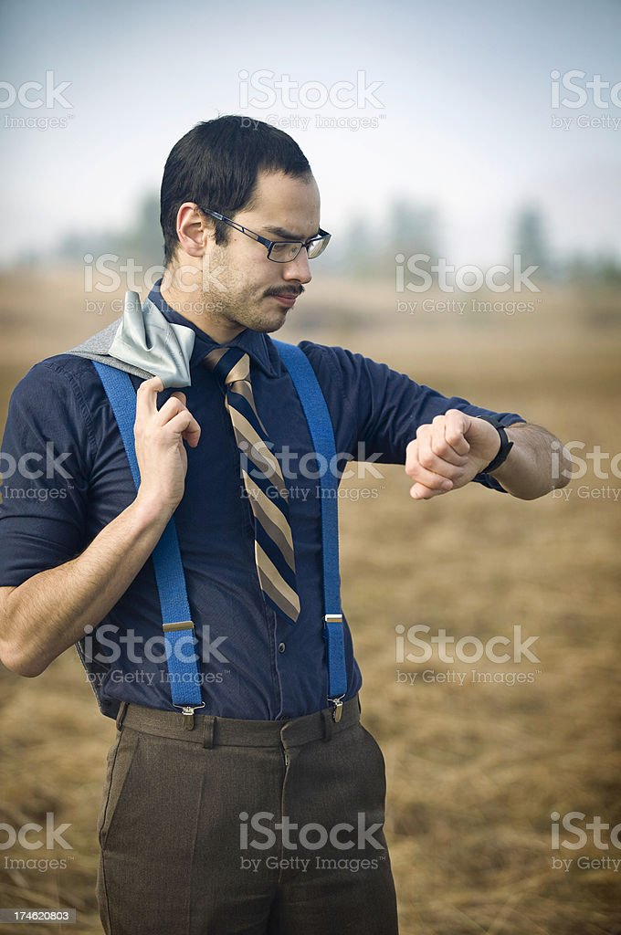 Young Ethnic Business Man Checking the Time royalty-free stock photo