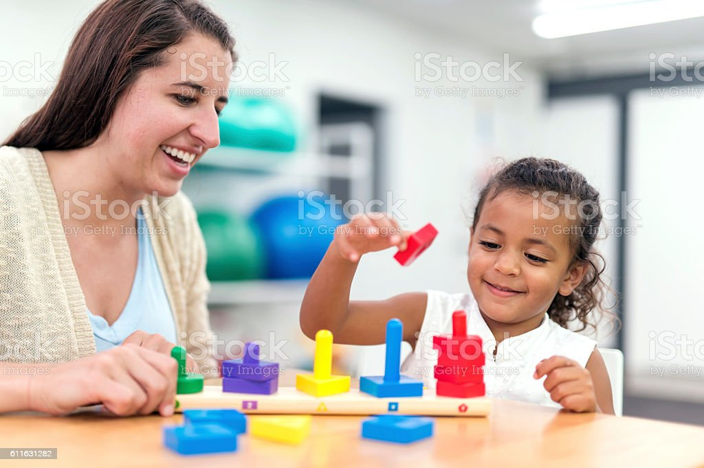 Young ethnic girl doing an exercise in a therapy session stock photo