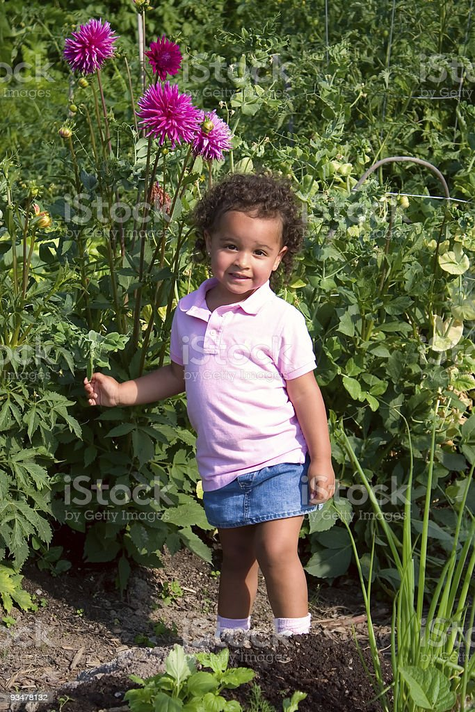 Young Ethnic Girl in Garden royalty-free stock photo