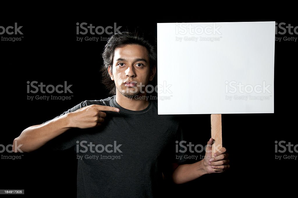 Young Ethnic Looking Man Pointing to Blank Sign stock photo