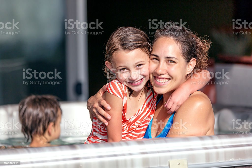 Young ethnic mother posing with her daughter in a stock photo