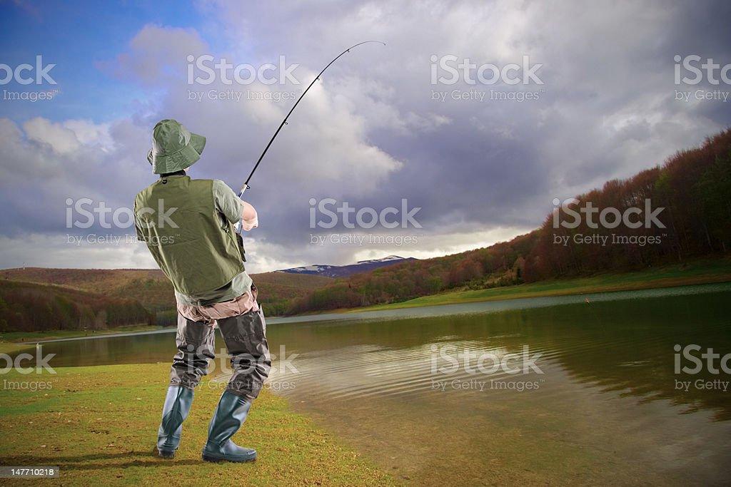 Young euphoric fisherman at Mavrovo lake royalty-free stock photo
