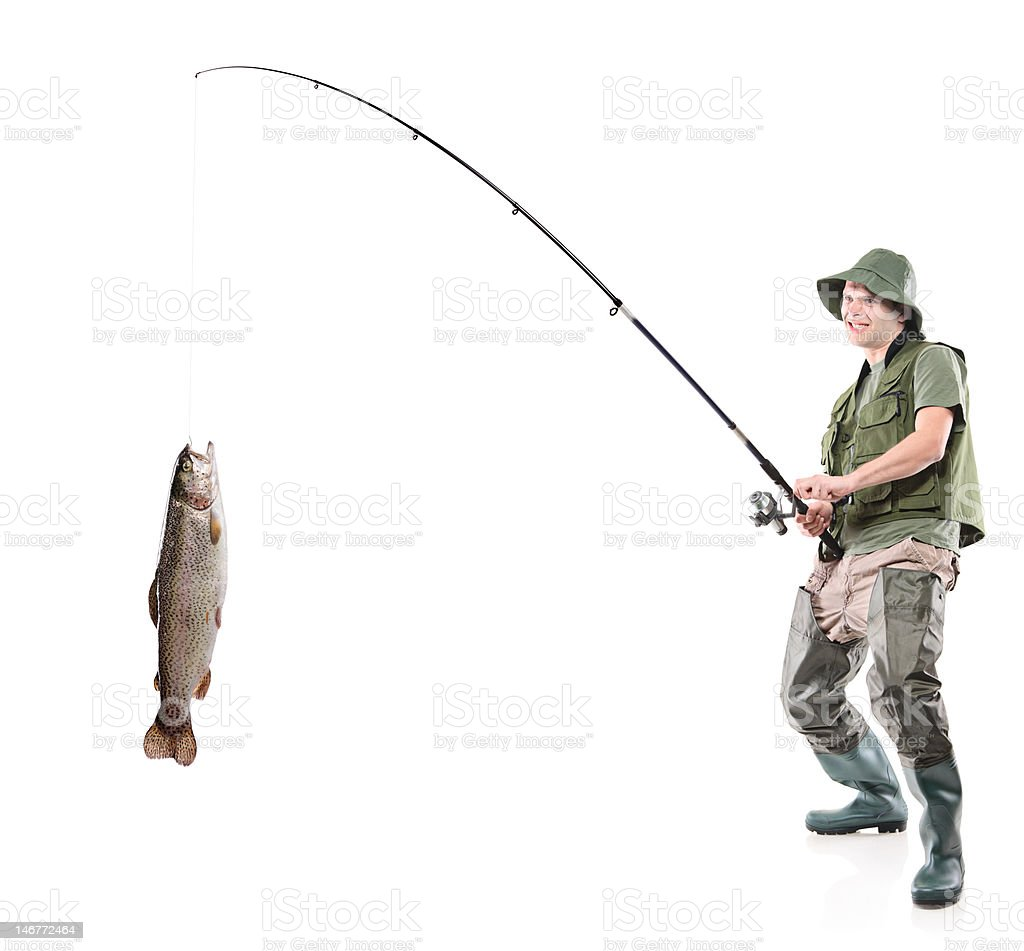 Young euphoric fisherman catching a fish stock photo