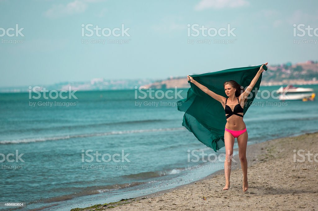 Young european woman runing by seaside at istanbul turkey stock photo
