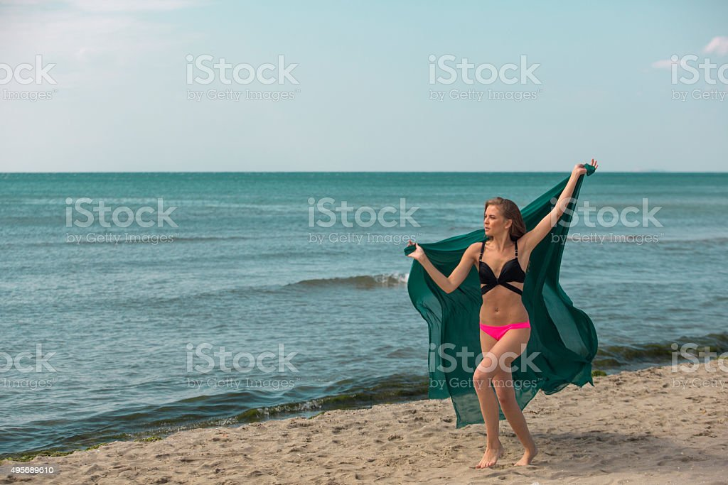 Young european woman running by seaside at istanbul turkey stock photo