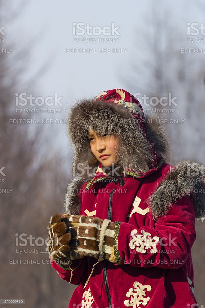 young Evenk in national costume stock photo