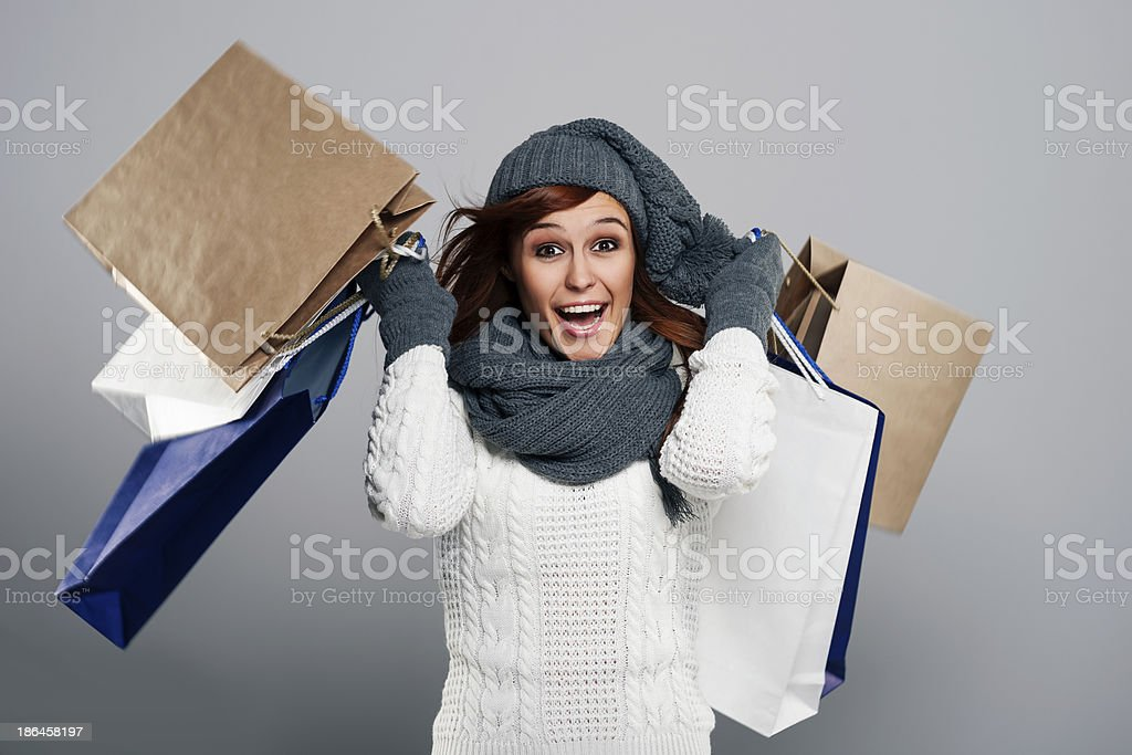 Young excited woman during the winter sale stock photo