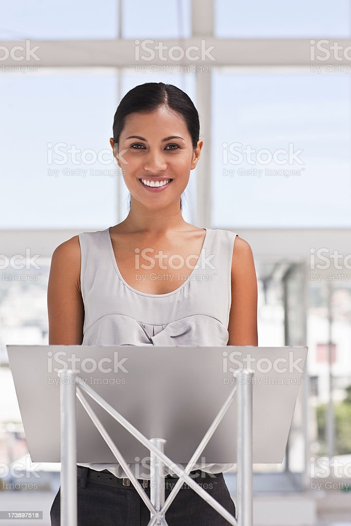 Young executive female at the podium giving her speech royalty-free stock photo