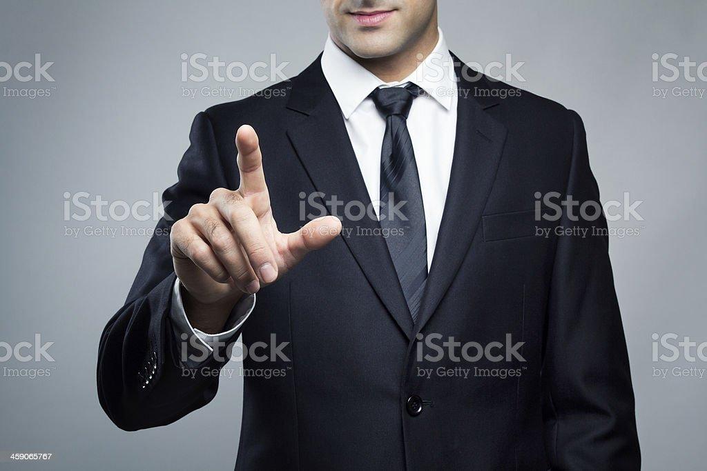 Young executive man touching an imaginary screen stock photo