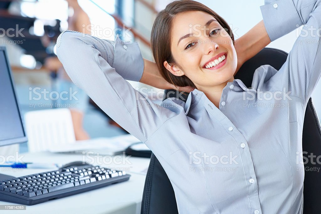 Young executive relaxing in office stock photo