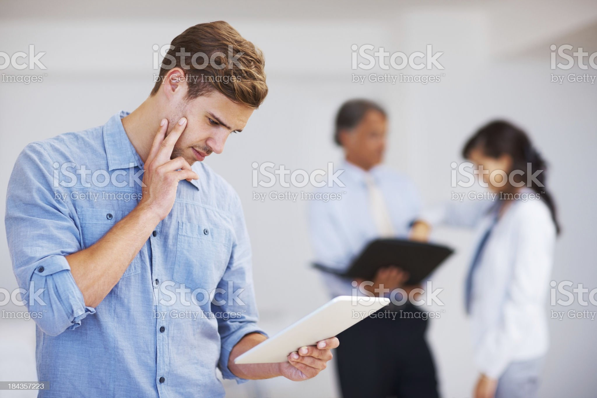 Young executive using tablet in office royalty-free stock photo