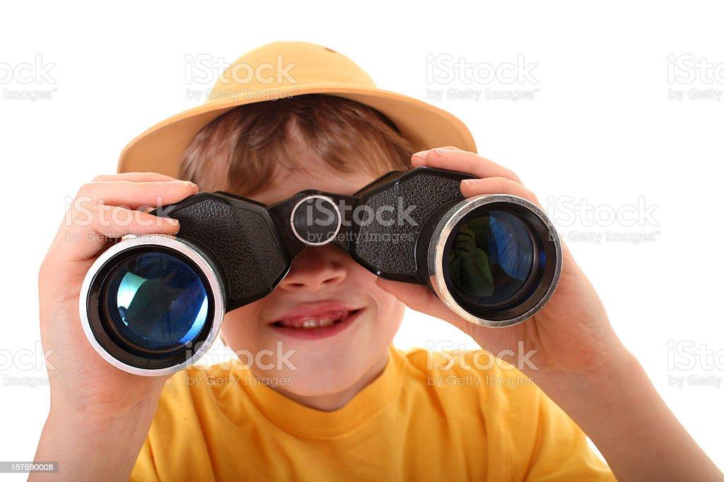 Young explorer boy using binoculars stock photo