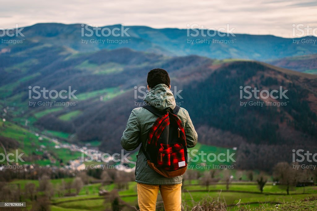 Young explorer in the mountains stock photo