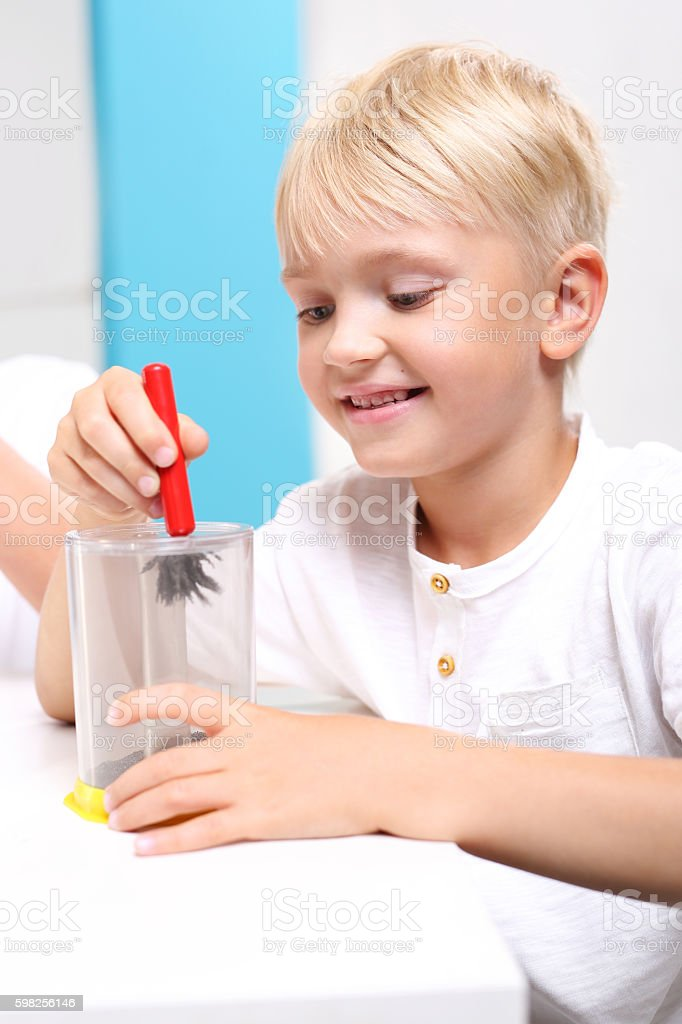 Young explorer. Lesson physics. Physical experiment. stock photo