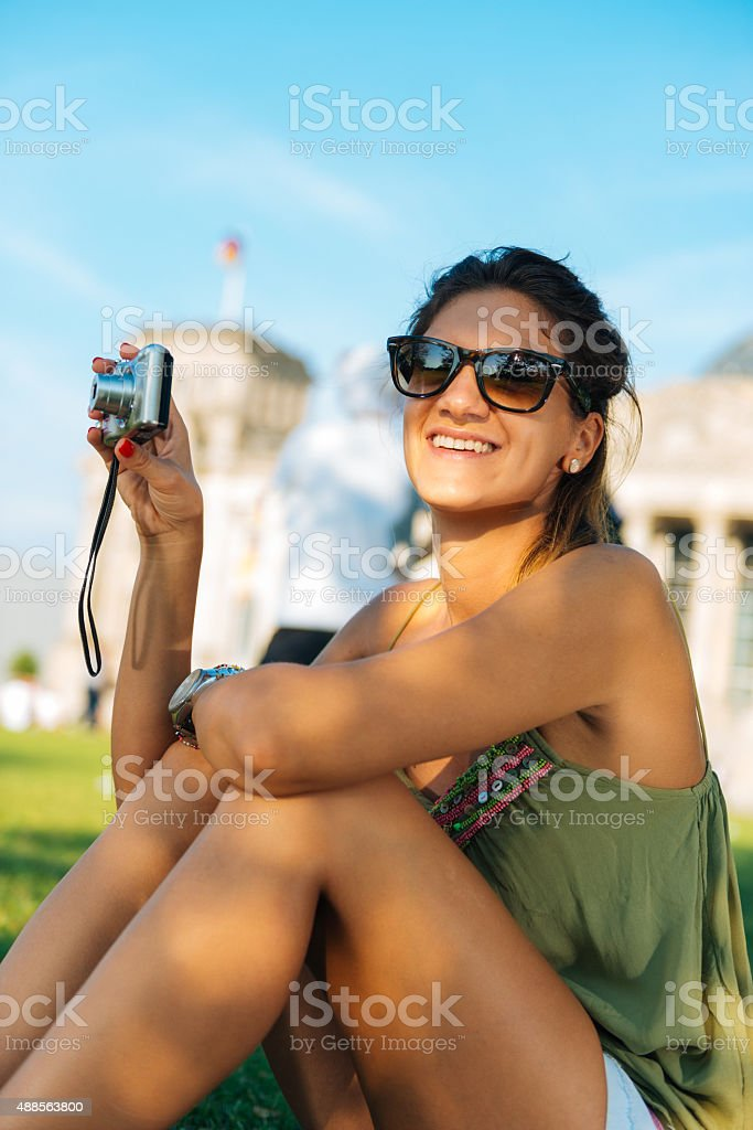 Young explorer taking shots with camera of famous landmark stock photo