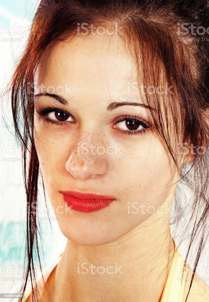 young face with freckles stock photo