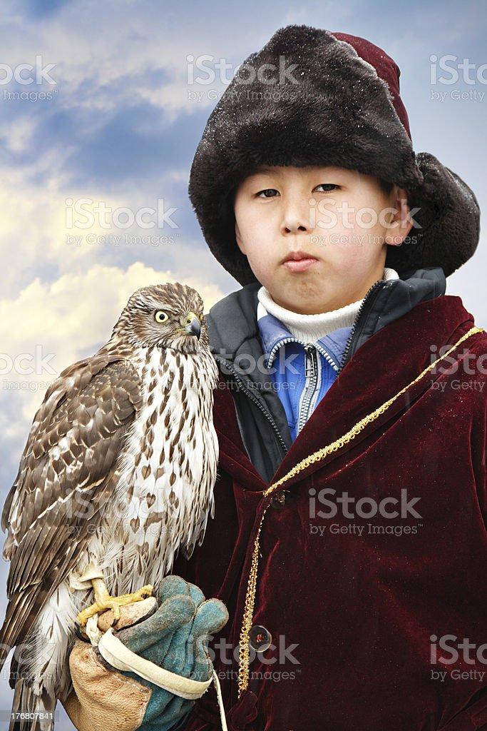 Young falcon hunter stock photo