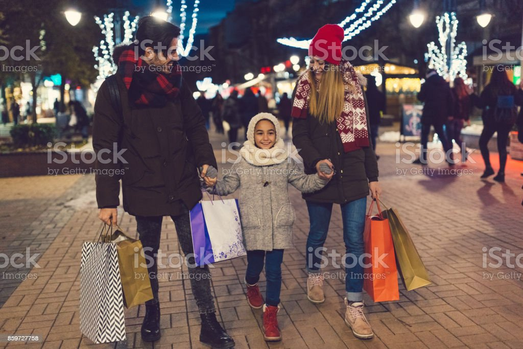 Family in the city during Christmas