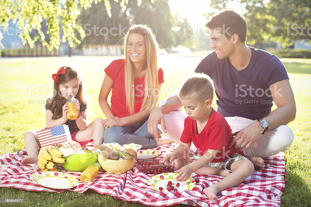 Young family at Fourth of July picnic royalty-free stock photo