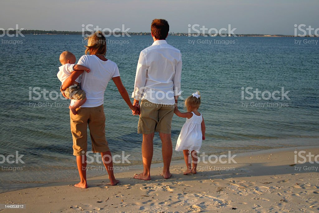 young family at the beach royalty-free stock photo