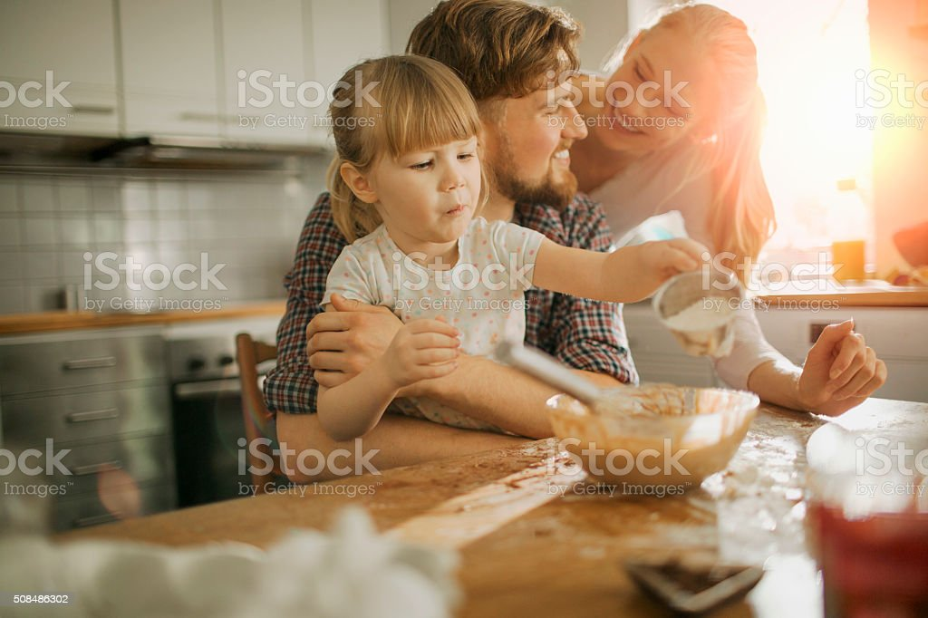 Young family baking together stock photo