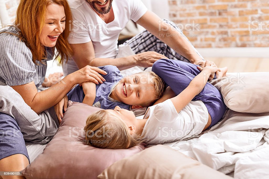 Young family being playful at home stock photo