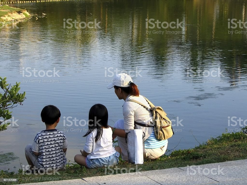 Young Family by the Lakeside royalty-free stock photo