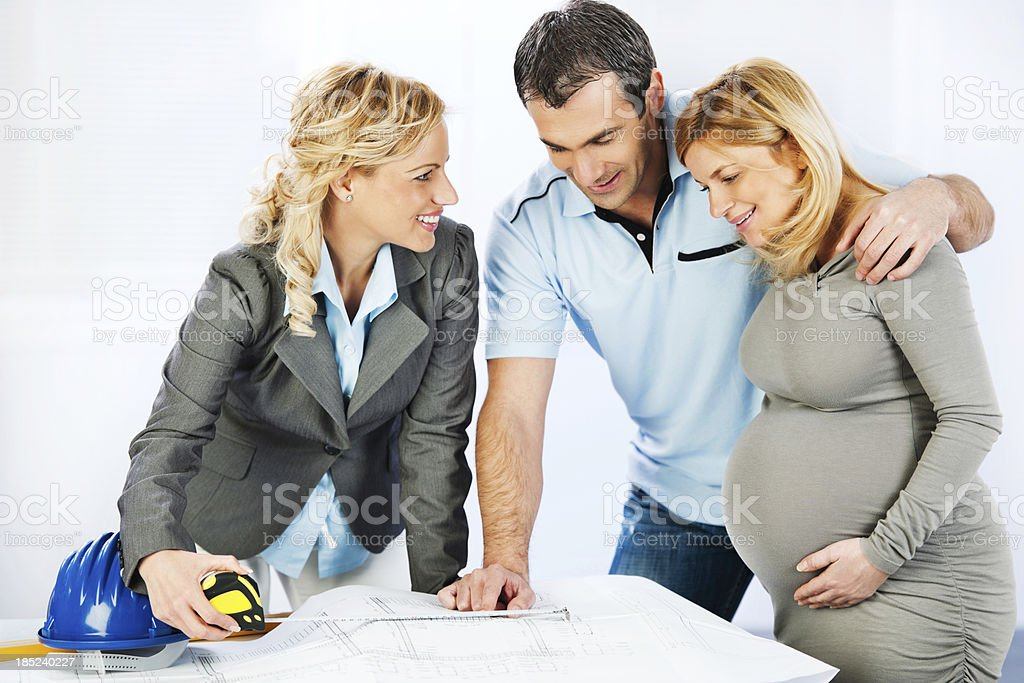 Young family consulting with a architect. royalty-free stock photo