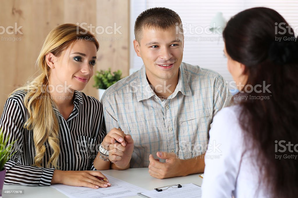Young family couple trying to get loan stock photo
