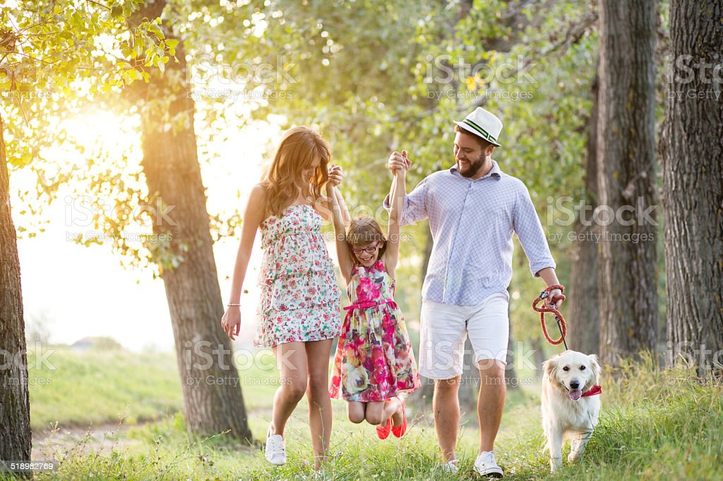Young family enjoy beautiful day with dog stock photo