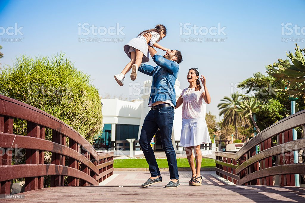 Young family enjoying life outdoor in a city park stock photo
