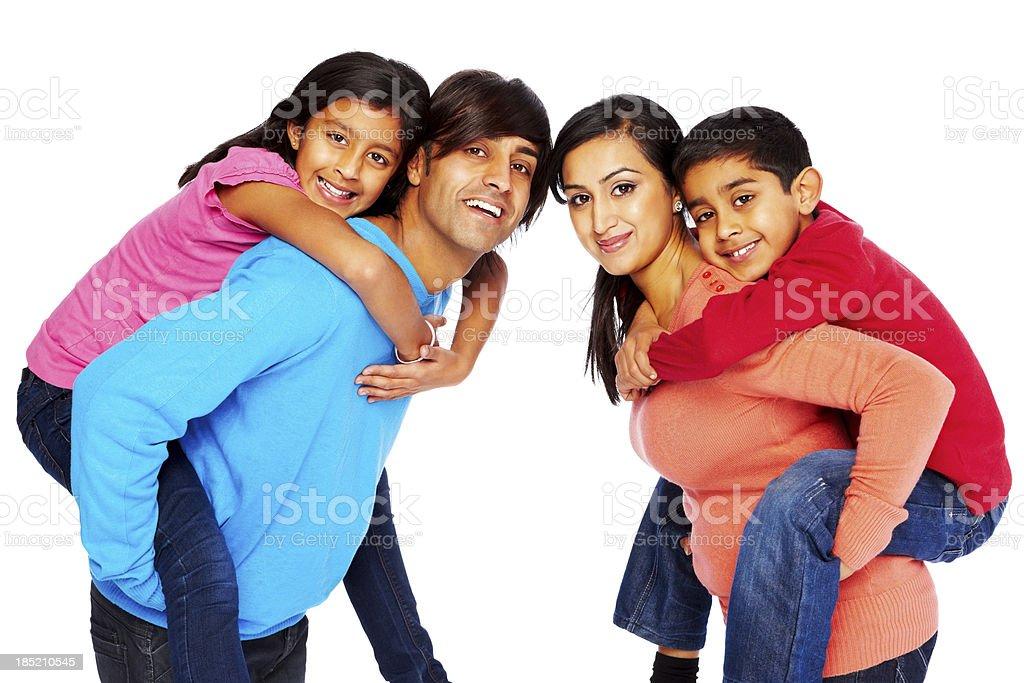 Young family enjoying piggyback ride royalty-free stock photo