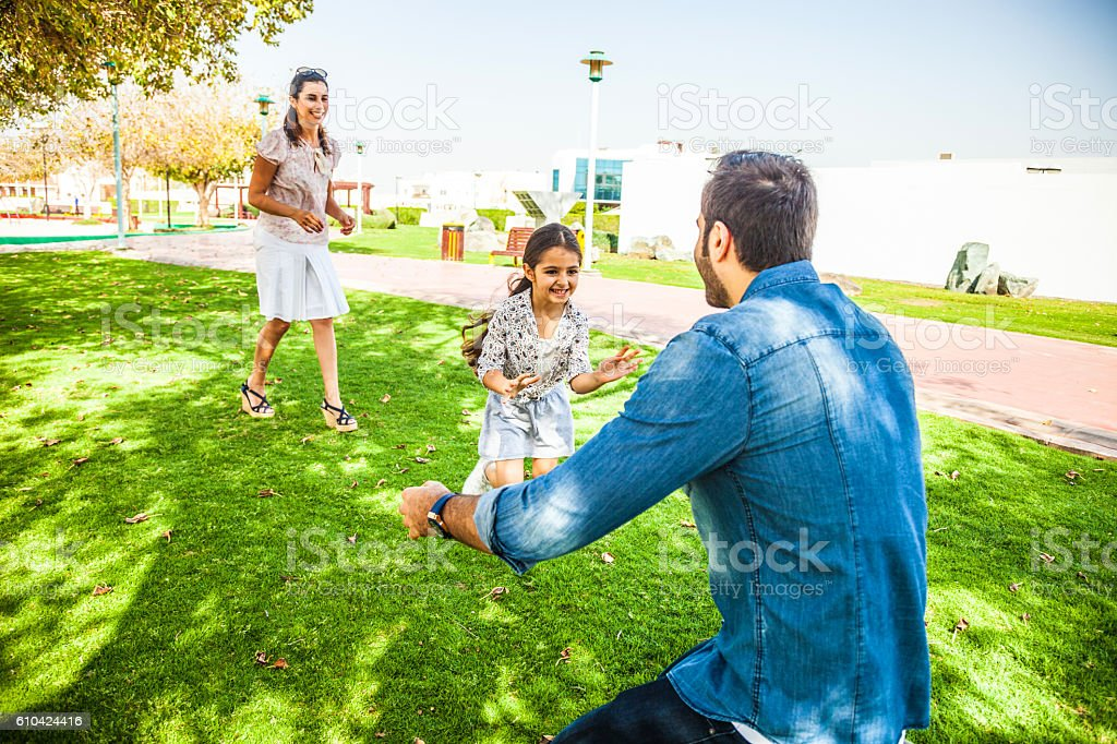 Young family enjoying sunday outdoor in a city park stock photo