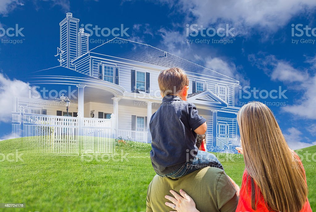 Young Family Facing Ghosted House Drawing Behind stock photo