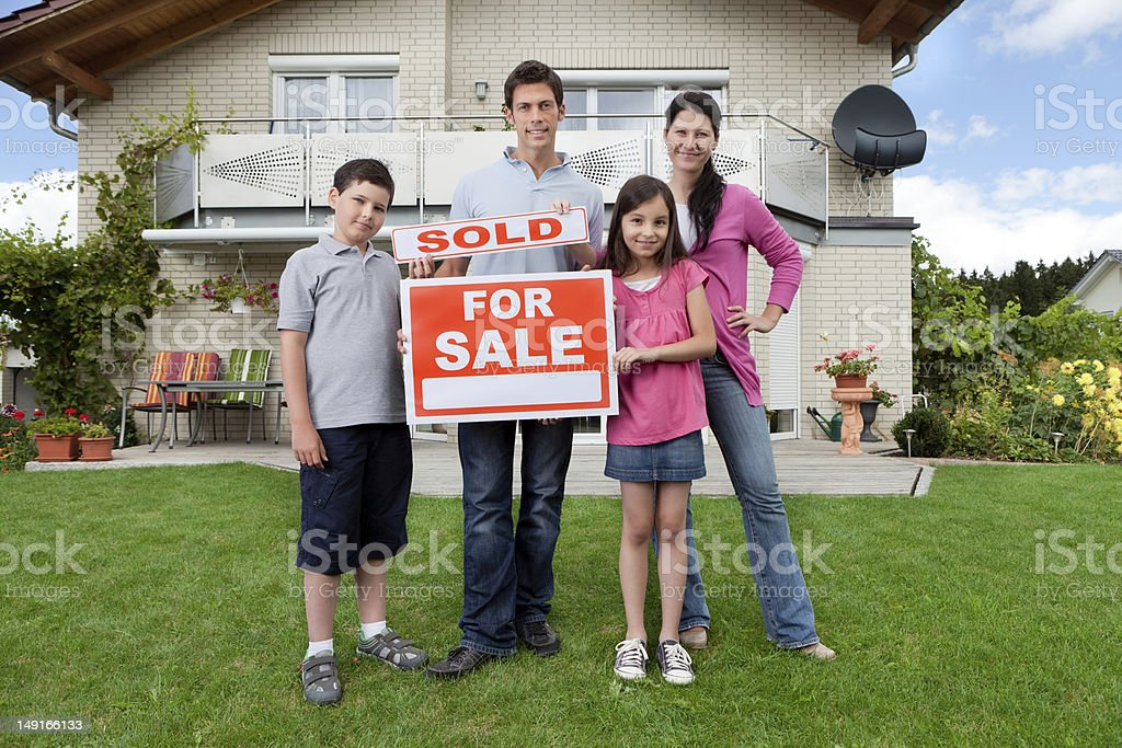 Young family happy to have bought a home royalty-free stock photo