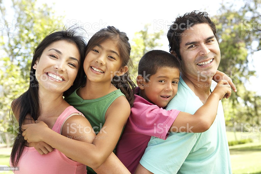 Young Family Having Fun In Park stock photo