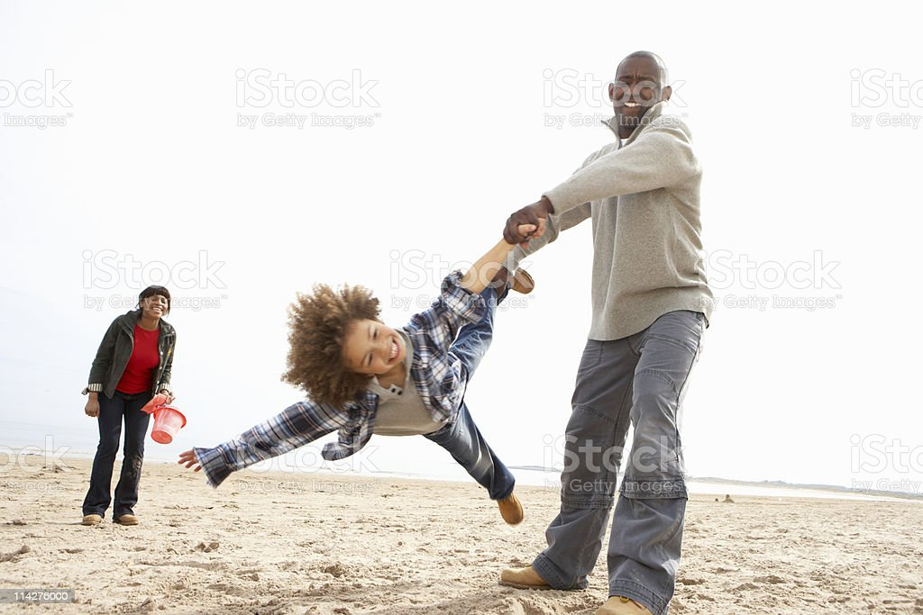 Young Family Having Fun On Beach Holiday royalty-free stock photo