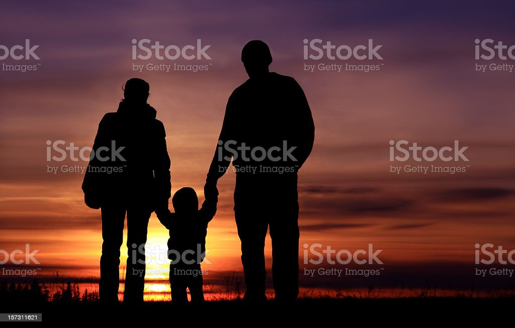 Young Family Holding Hands on a Nature Hike stock photo
