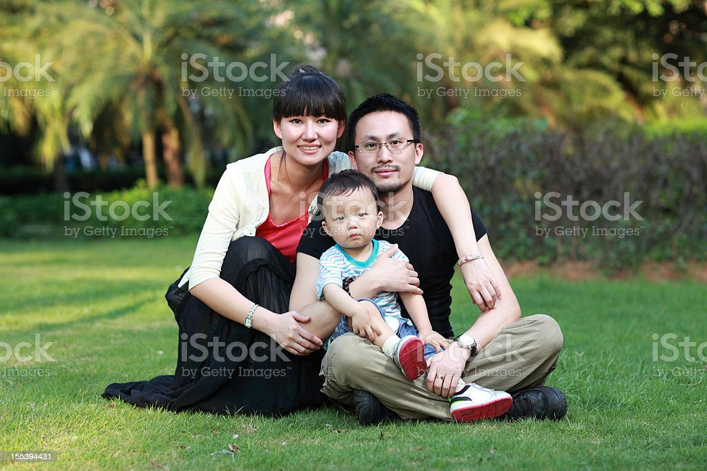 Young family in a park royalty-free stock photo