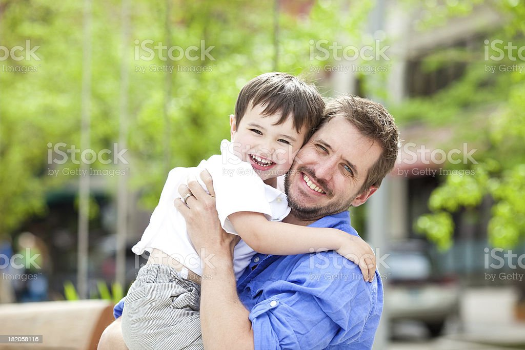 Young family in an urban park. royalty-free stock photo