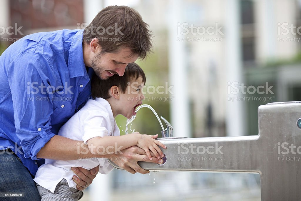 Young family in an urban park. stock photo