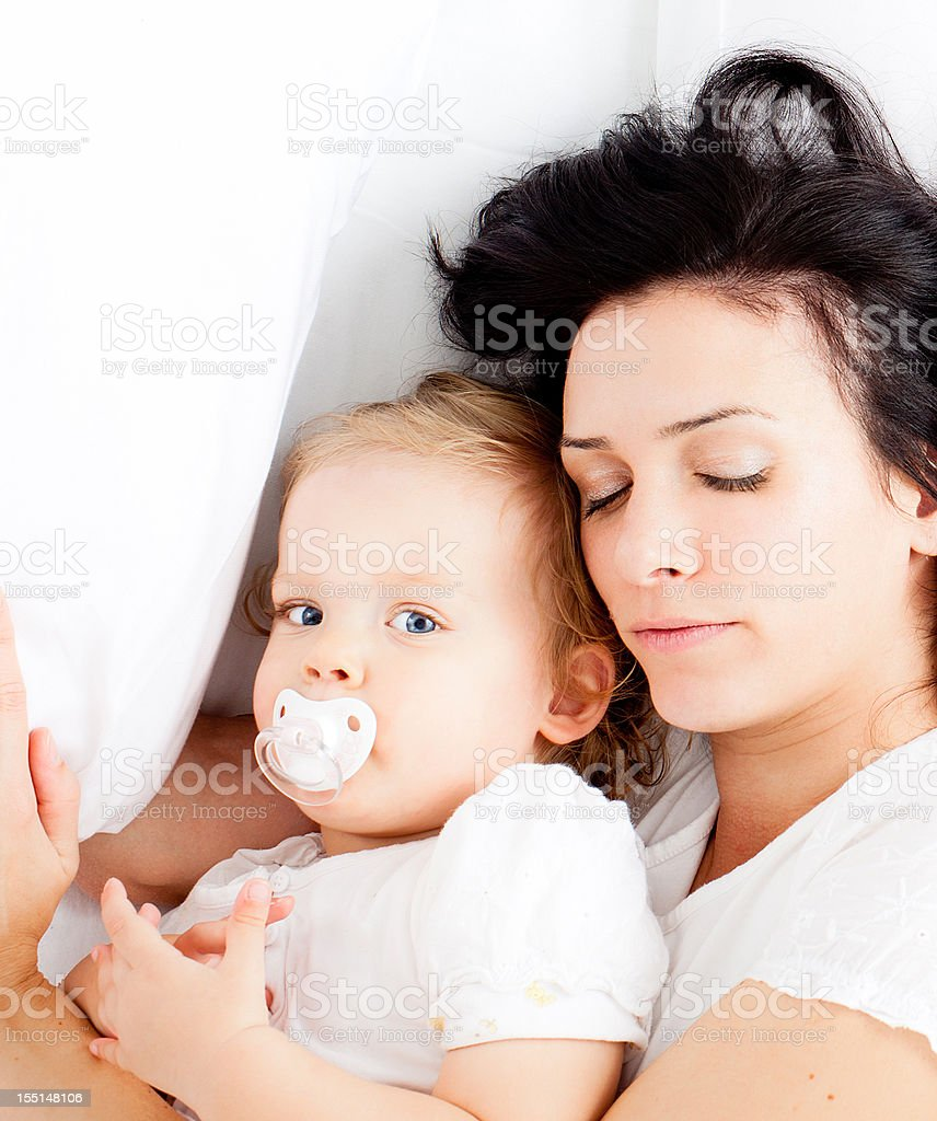 Young family in bed royalty-free stock photo