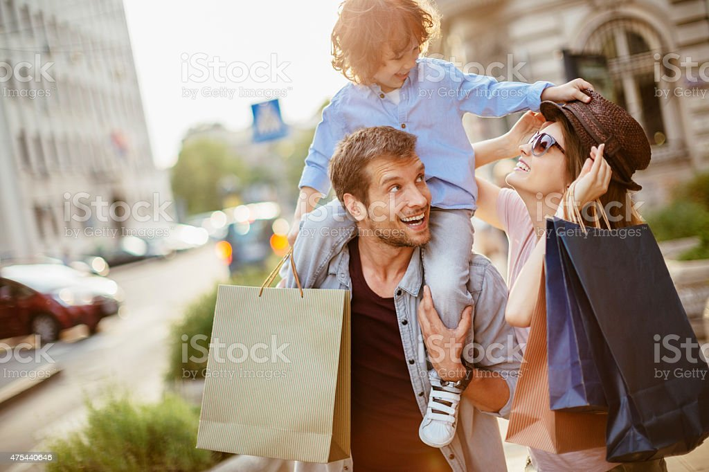 Young family in shopping stock photo
