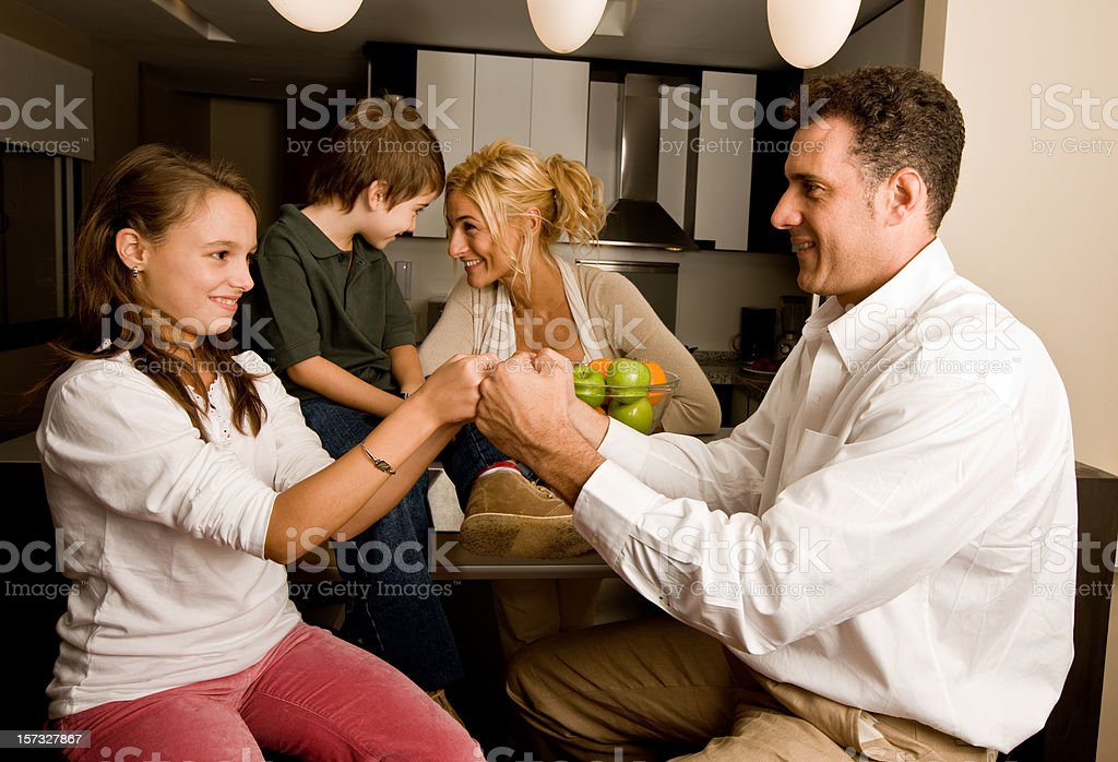 Young family in the kitchen royalty-free stock photo