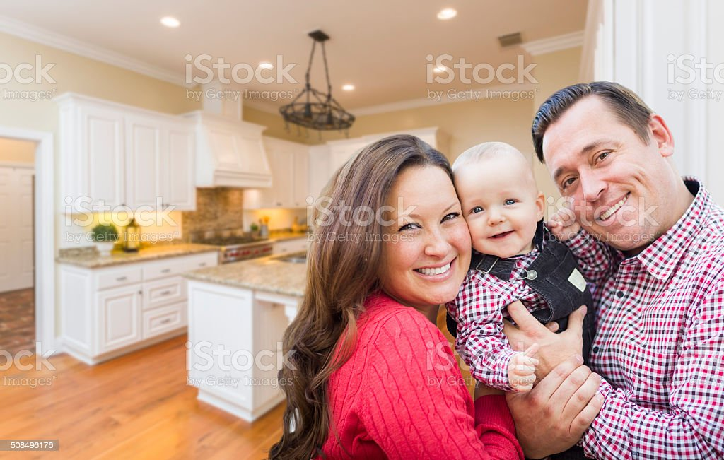 Young Family Inside Beautiful Custom Kitchen stock photo