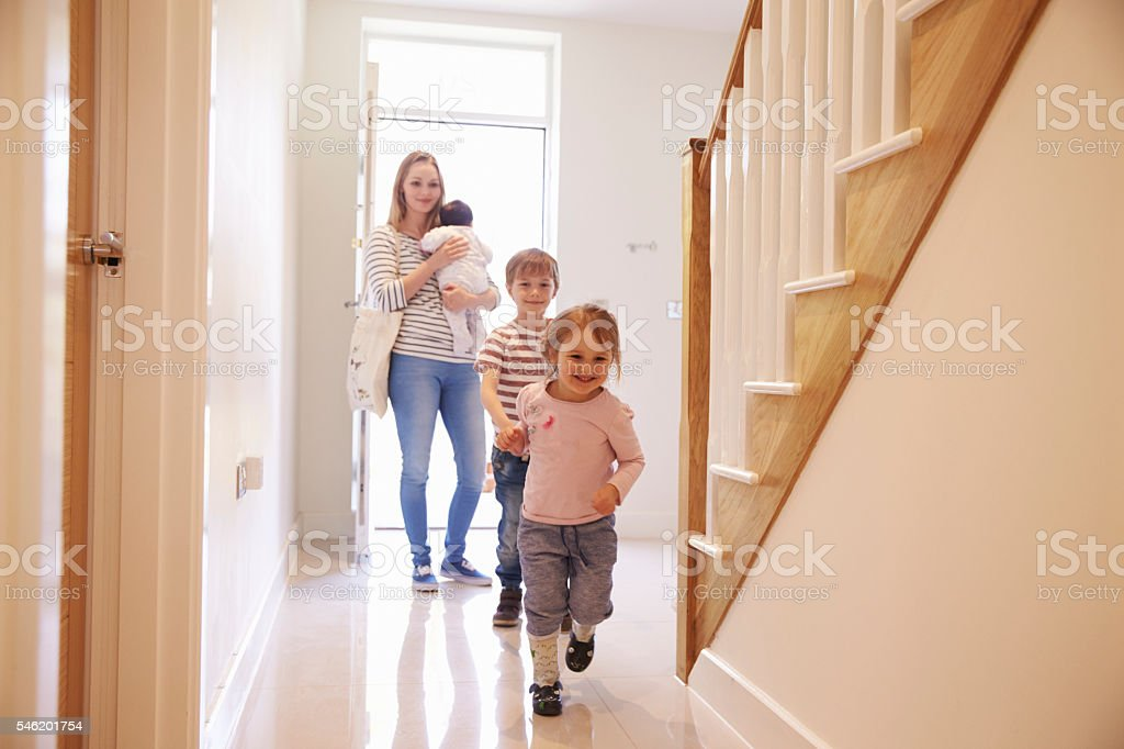 Young Family Looking Around Property For Sale stock photo