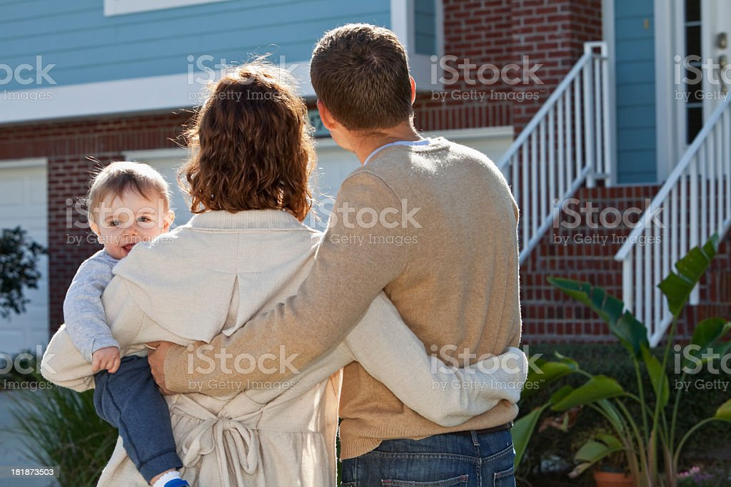 Young family looking at house stock photo