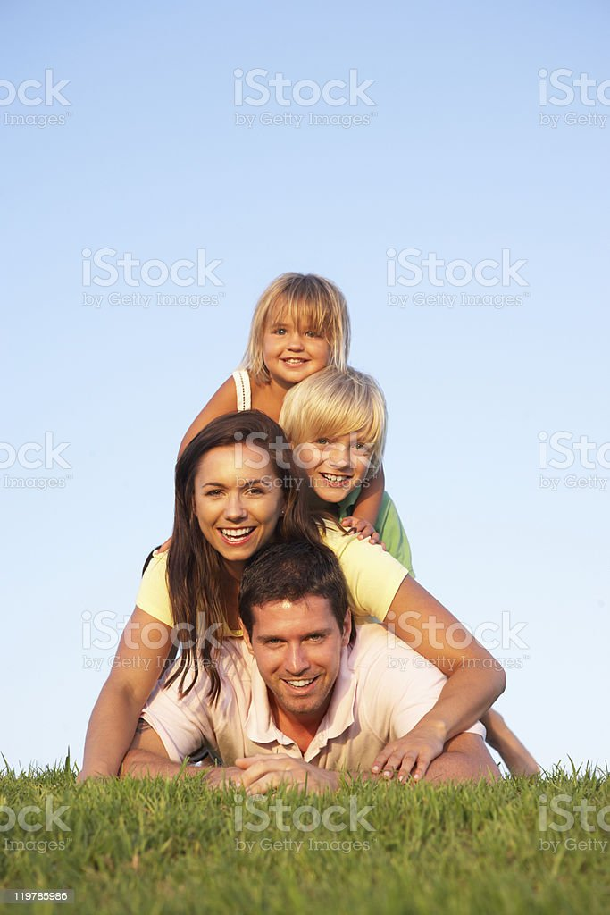 Young Family Lying in Field royalty-free stock photo