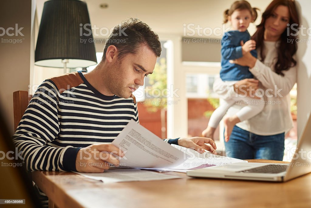 young family money troubles stock photo