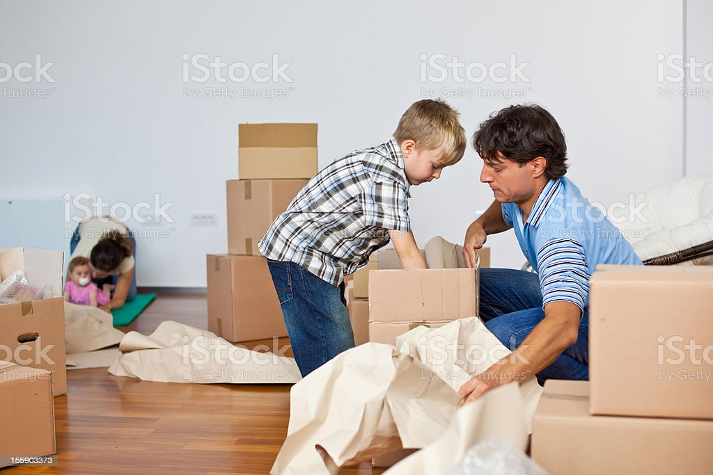 Young Family Moving Into New Home royalty-free stock photo